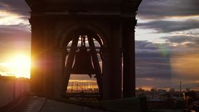 Bell Tower of St. Petersburg Cathedral during amazing sunset on cloudy sky with lense flare effects. 3840x2160. Bell Tower of Cathedral during amazing sunset on stock video footage