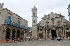 Bell tower of the cathedral and arcades. Ancient historic architecture of the cathedral of Havana home to much tourism Stock Images