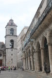 Bell tower of the cathedral and arcades. Monumental architecture located in one of the many squares of Havana home to much tourism stock photography