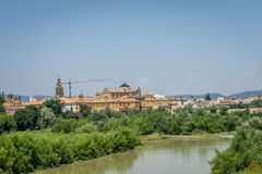 The bell tower and Cathedral mosque of Cordoba from the bridge o. The Mezquita de Córdoba,the Great Mosque of Córdoba, Mosque-Cathedral,Mezquita and bell stock photo