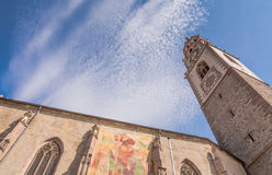 the bell tower of the Cathedral of St. - Nicholas in Merano, Bolzano, south Tyrol, Italy Royalty Free Stock Photo
