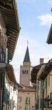 Bell tower of Cathedral of town of Venzone in italy Stock Photos