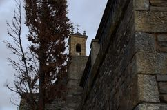 The bell tower of the catholic church. A bell tower or body of bells is a structure built to place bells. ... A church may have more than one belfry and each Royalty Free Stock Images