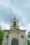 Bell tower of the chapel in the countryside in the background of the cloudy sky Royalty Free Stock Images