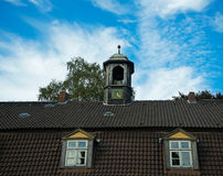 Bell tower with chimes on roof of the old house Royalty Free Stock Photos