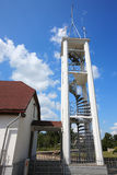 Bell tower of Christian church in small town Stock Images