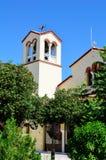 Bell tower of a  Church in a green garden Stock Photos