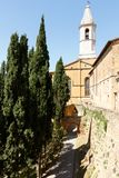 Pienza, Italy bell tower against blue sky royalty free stock photography