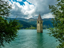 Bell tower of the Church in the Resia lake - 1 Stock Photo