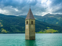 Bell tower of the Church in the Resia lake - 3 Stock Images