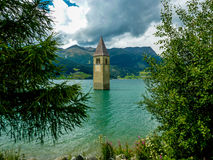 Bell tower of the Church in the Resia lake - 4 Stock Photography