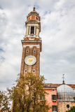 The bell tower of the Church Saint Apostoli - Venice, Italy Royalty Free Stock Photos