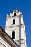 The bell tower of the church of St. John. Against the blue sky. Vilnius. Lithuania Stock Photos