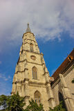 Bell tower of Church St. Michael in Cluj-Napoca, Cluj county, Romania. Gothic architecture of Church St. Michael in Cluj-Napoca, Romania with partly cloudy blue Royalty Free Stock Photos