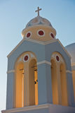 Bell tower of a church at sunset, Imerovigli village, Santorini island Royalty Free Stock Photography