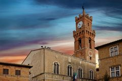 Bell tower and city hall of Pienza Tuscany Italy sunset or sunrise. Bell tower and city hall of Pienza Tuscany Italy at sunset or sunrise stock images