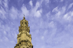 Bell tower of the Clerigos Church in cloudy blue sky background. Stock Photo