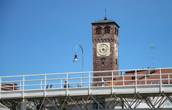 Bell tower with clock. Blue sky Stock Photos