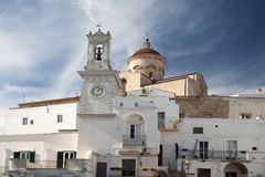 Bell tower with clock in Pisticci south Italy royalty free stock image