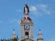 Bell Tower with Clock and Statue of Jesus on a Village Church Royalty Free Stock Photos