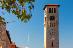 Bell tower with clock during sunset time Stock Photography