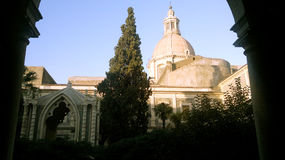Bell tower and cloister, Campanile e chiostro. Bell tower and cloister of Monastero dei Benedettini, Catania stock photo