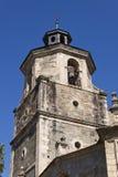 Bell tower in Collegiate Church of Santa Maria Stock Image