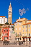 Bell tower and colorful buildings at Tartini square in Piran, Istria Royalty Free Stock Photos