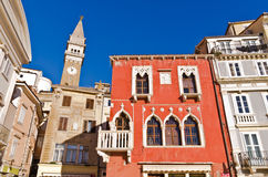 Bell tower and colorful buildings at Tartini square in Piran, Istria Royalty Free Stock Image