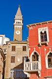 Bell tower and colorful buildings at Tartini square in Piran, Istria Stock Photos