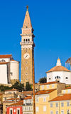 Bell tower and colorful buildings at Tartini square in Piran, Istria Stock Image