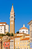 Bell tower and colorful buildings at Tartini square in Piran, Istria Stock Photography