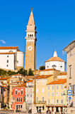 Bell tower and colorful buildings at Tartini square in Piran, Istria Stock Images