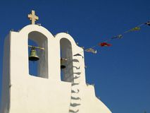 Bell Tower, Cross and Flags in Greece Stock Photos