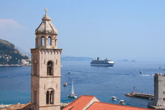 Bell tower and cruise ship. Beautiful view of Dubrovnik old bell-tower and cruise ship in Croatia Royalty Free Stock Photography