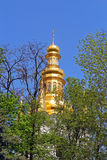 Bell tower of distant caves hidden in the spring foliage, Kyiv Stock Image