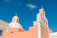 Bell tower and dome of a church at Oia village, Santorini island Stock Photo