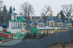 Bell tower and domes of the Syato-Uspensky Pskovo-Pechorsky monastery. Pechory, Pskov region. Russia Royalty Free Stock Photography