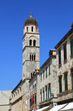 Bell tower in Dubrovnik. View from the stradun street to the bell tower of Franciscan Monastery, Dubrovnik, Croatia Royalty Free Stock Images