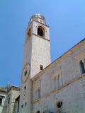 Bell tower in Dubrovnik city. Low angle view of a historic bell tower in the city of Dubrovnik, Croatia Stock Photography