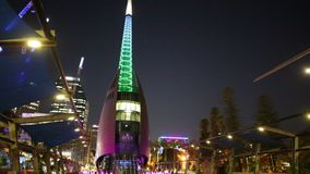 Bell Tower at dusk. Perth, Australia - Jan 5, 2018: Bell Tower or Swan Bell Tower and construction cranes illuminated by night lights in Perth city, Western stock video