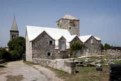 Bell tower, fort and houses on island Brac Royalty Free Stock Photo