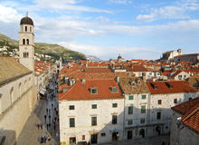 The Bell Tower of Franciscan Church and Historical Buildings of the Old City of Dubrovnik Stock Image