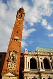 Bell tower in front of the Palladian Basilica in Vicenza in Veneto (Italy). Photo taken at the Palladian Basilica in Vicenza in Veneto (Italy). In the image stock photography