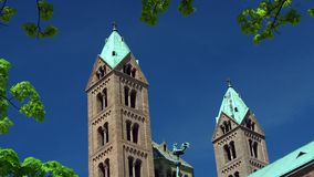 Bell tower front of the Speyer Cathedral, famous UNESCO world heritage site. Facade of the famous UNESCO World Heritage Site Speyer Cathedral, Speyer, Germany stock video footage