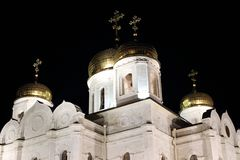 Bell tower and golden domes with crosses. The Cathedral of Christ the Savior at night. Pyatigorsk, Russia. Bell tower and golden domes with crosses. The stock images