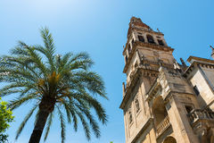 Bell tower of the Great Mosque Cathedral in Cordoba, Spain. View of the bell tower and former minaret of the Mosque-Cathedral of Córdoba against a clear blue Stock Photo