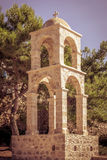 Bell tower in Greece. Stone bell tower on greek Kos island Royalty Free Stock Photo
