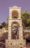 Bell tower in Greece. Stone bell tower on greek Kos island Royalty Free Stock Images
