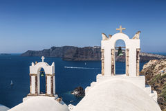 The bell tower Greek Orthodox Church in the small town of Oia in Santorini, Greece Royalty Free Stock Photos